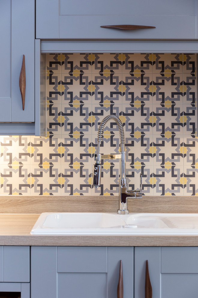 kitchen sink with background tiles