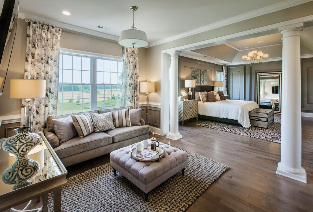 Bedroom with High Ceiling and Hardwood Floors