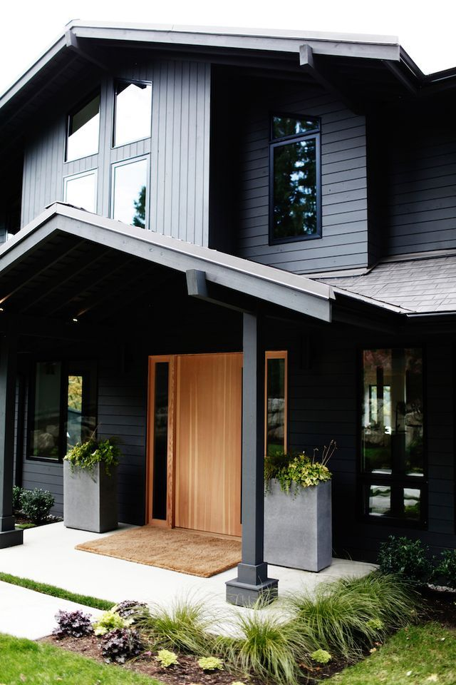 Black House with Wooden Brown Door