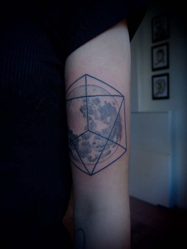 World Inside Geometric Shape Tattoo on Hand