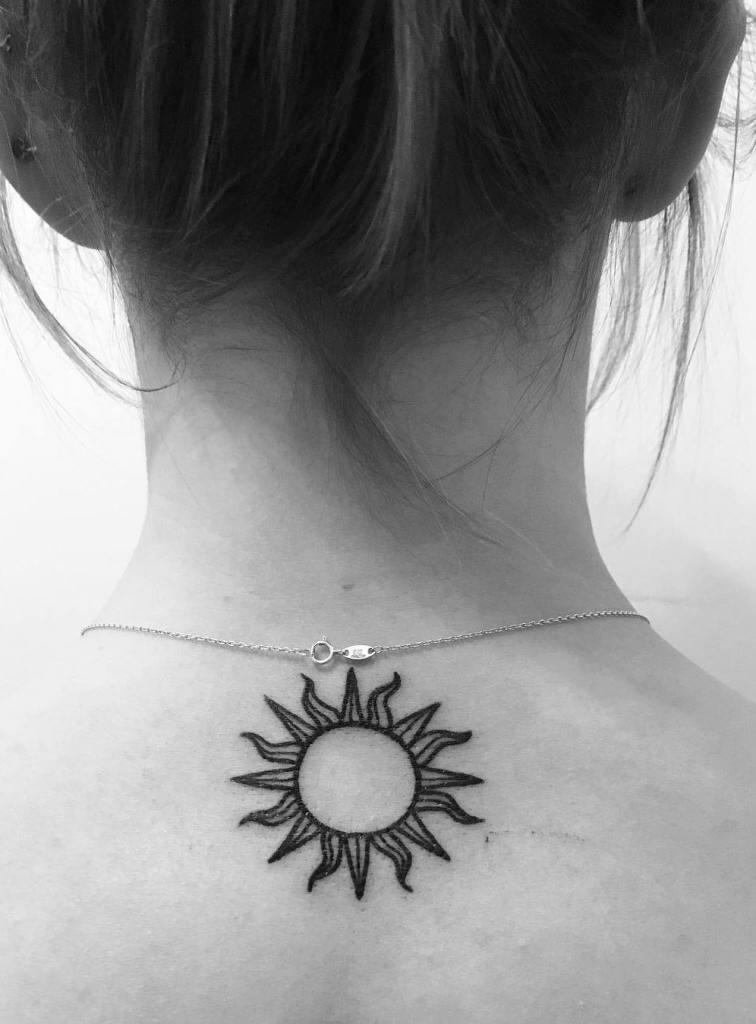 Sun Tattoo on Back of Neck