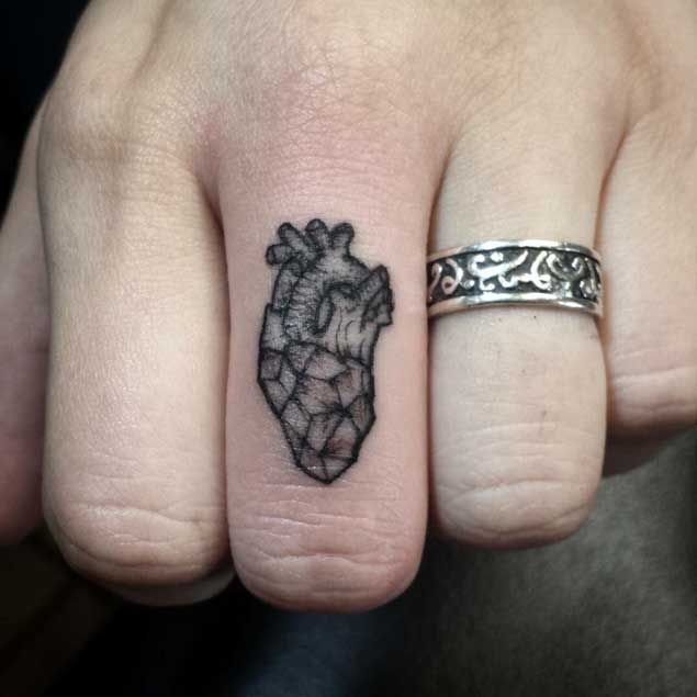 Tiny Heart Finger Tattoo