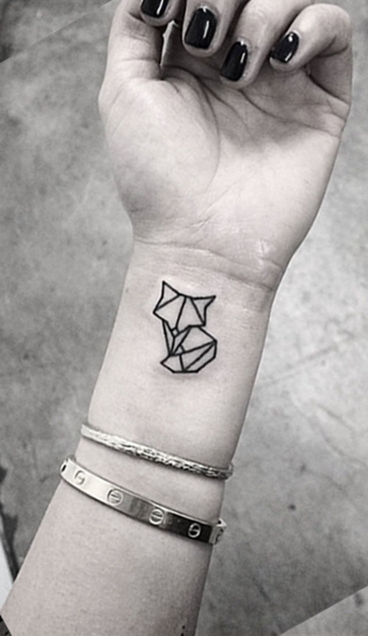 geometric wrist tattoos